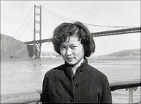 Cathy Woo on a boat by the Golden Gate bridge
